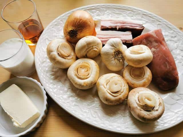 ingredients for pork fillet sauce on white plate