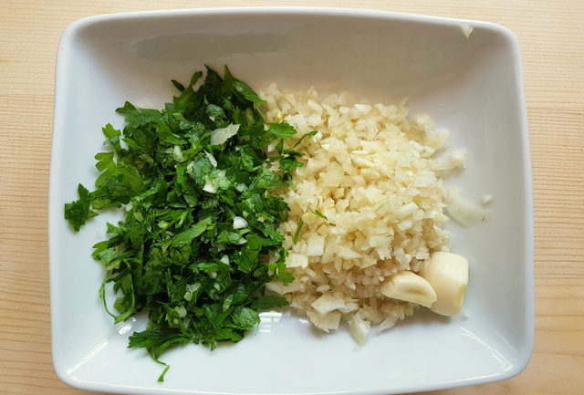 chopped parsley and fennel in white bowl