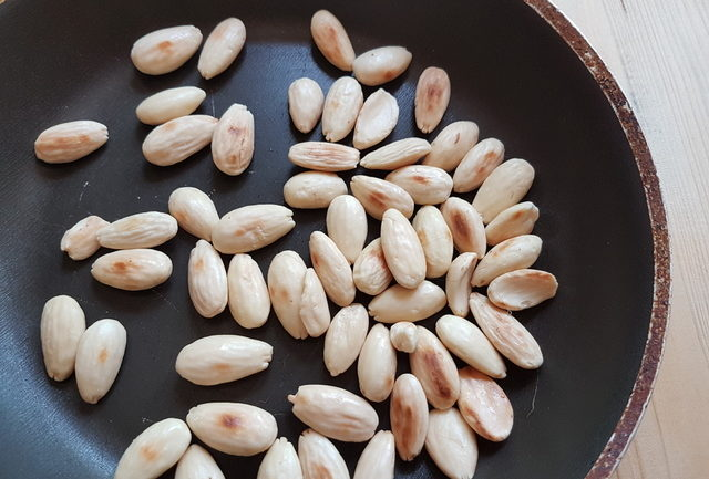 toasted almonds in frying pan