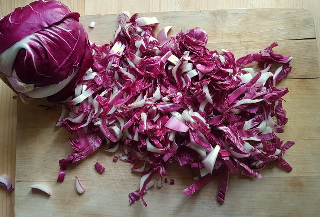 Shredded radicchio for fettuccine pasta with speck and radicchio (Italian chicory)