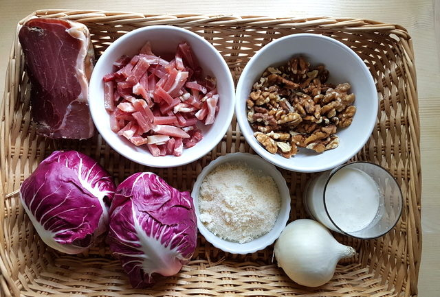 Ingredients in basket for fettuccine Pasta with speck and radicchio (Italian chicory)