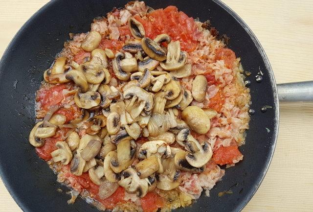 mushrooms and tomato sauce in frying pan for garganelli pasta alla zingara