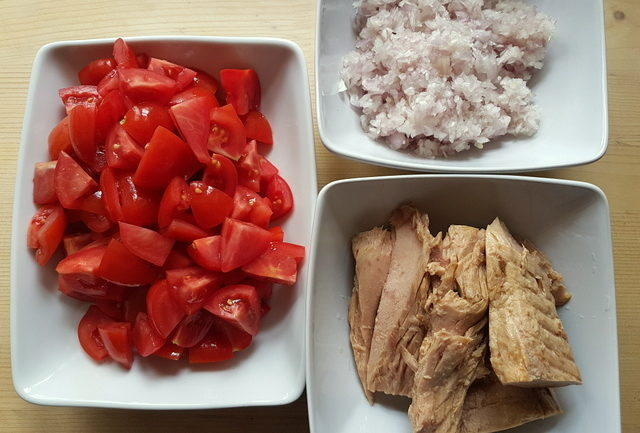 chopped tomatoes, drained canned tuna and finely chopped onion in 3 white bowls