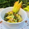 Pasta with zucchini flowers, saffron and ham
