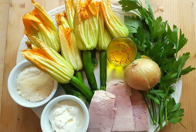 Ingredients for pasta with zucchini flowers, saffron and ham