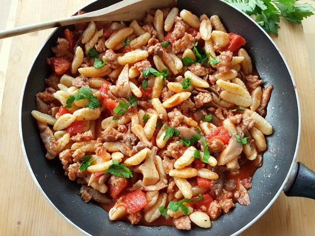 homemade cavatelli pasta with oyster mushrooms and sausage