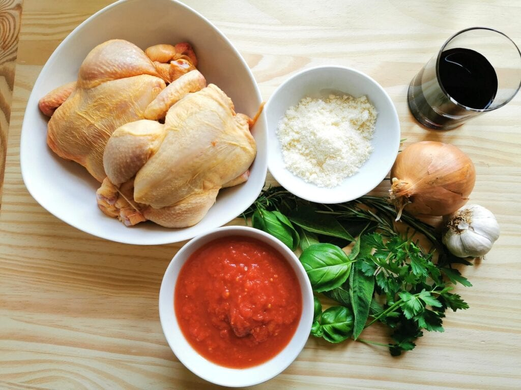 ingredients for free-range chicken ragu on wooden board