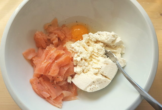 smoked salmon, ricotta, Parmigiano and egg in white bowl