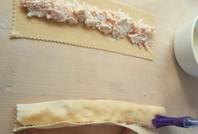 2 fresh pasta rectangles with smoked salmon filling