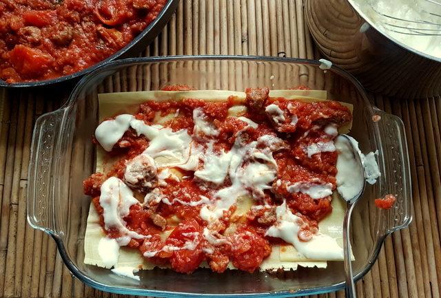 lamb lasagna layers of pasta and sauce in oven dish