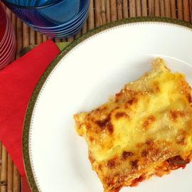 lamb lasagna in white plate