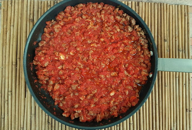 lamb lasagna sauce cooking in frying pan