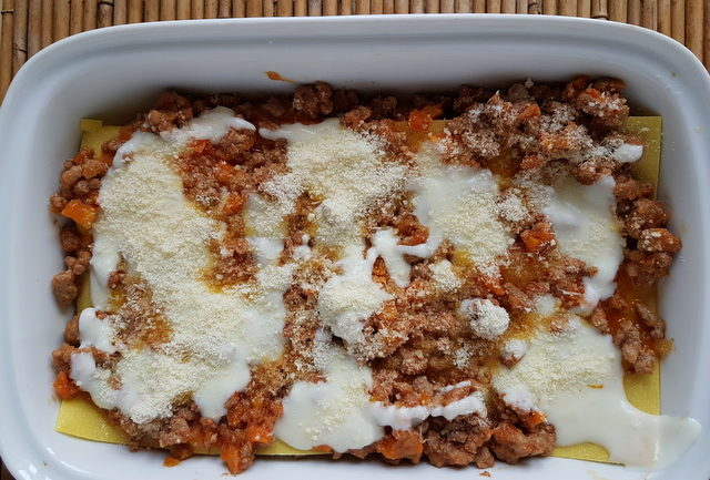 lasagne al forno with bolognese in white oven dish