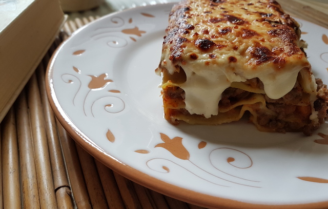 lasagne al forno with bolognese on white terracotta plate