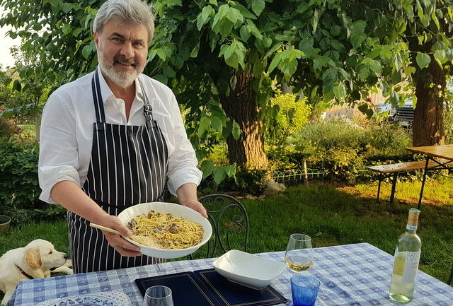 My Sicilian husband Salvatore serving the Linguine pasta alle vongole he cooked