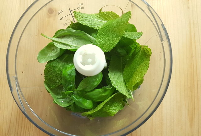 fresh mint and basil leaves in food blender