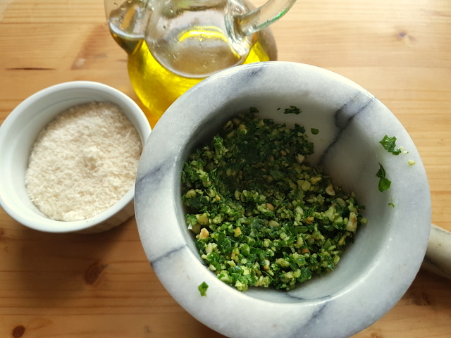 making pesto with a pestle and mortar