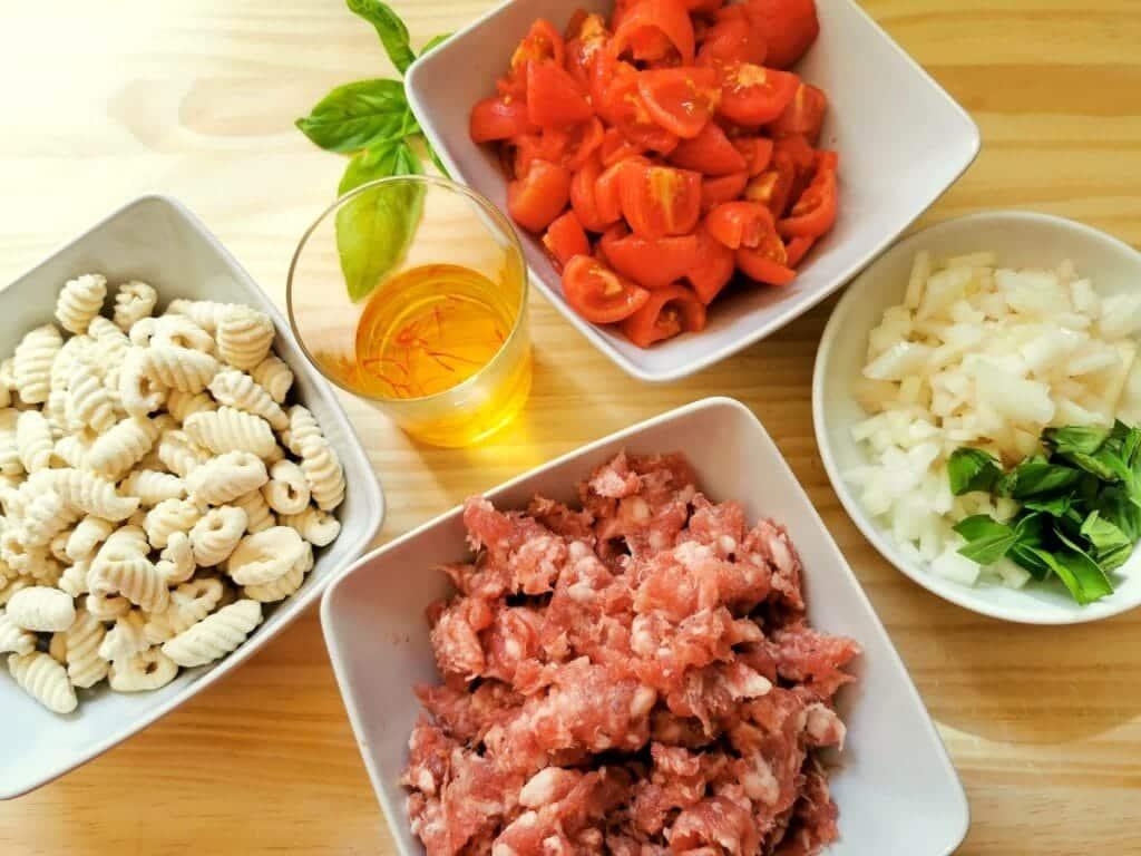 Prepared ingredients for Sardinian gnocchi-malloreddus alla campidanese