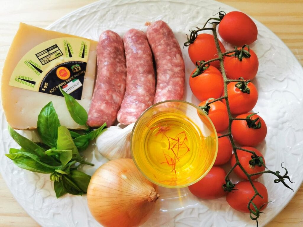 Ingredients for sausage, tomato and saffron sauce for malloreddus alla campidanese