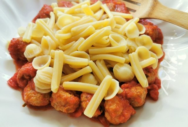 orecchiette maritate added to meatballs and sauce