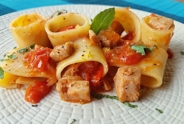 paccheri pasta with fresh tuna ragu on white plate