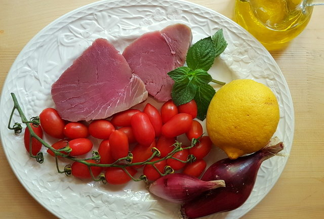 ingredients for fresh tuna ragu on white plate