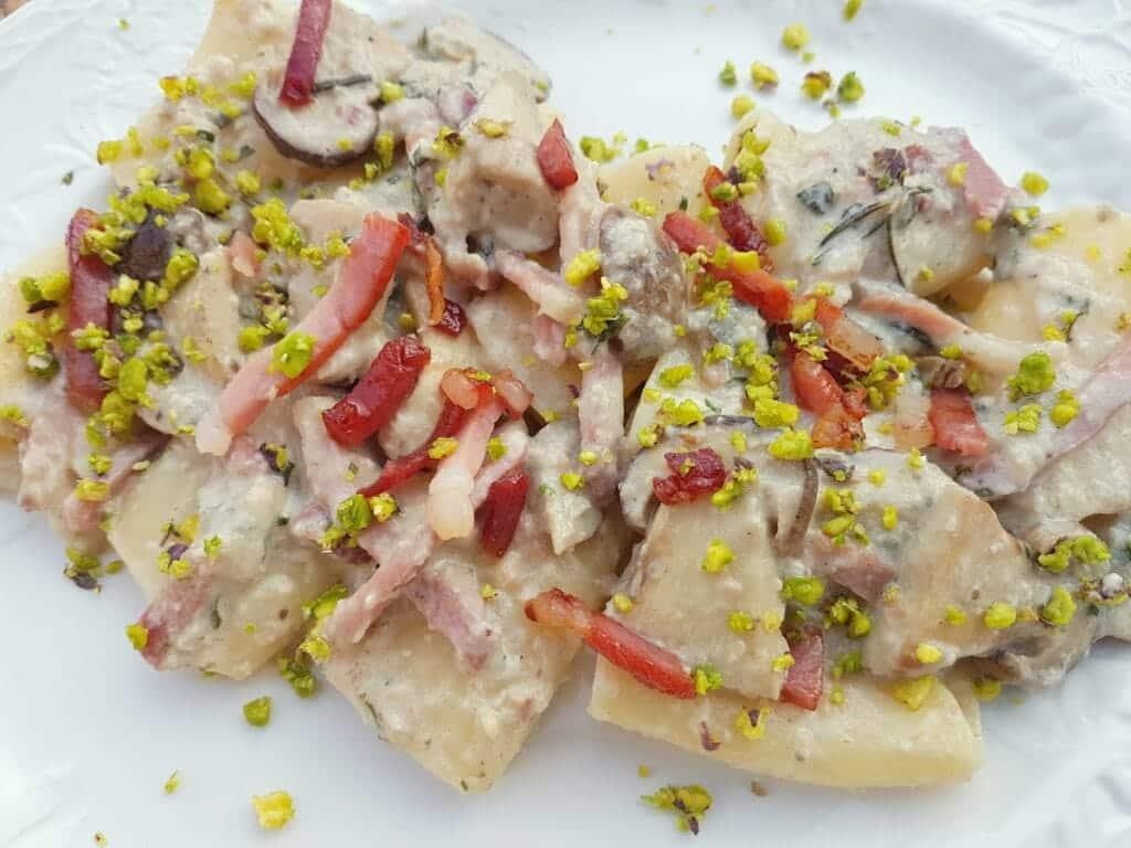 Paccheri with porcini, speck and pistachio