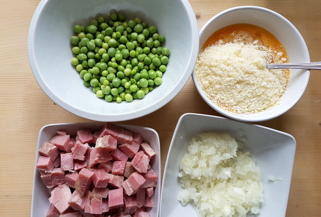 chopped ham, shelled peas, chopped onion and beaten eggs in separate white bowls
