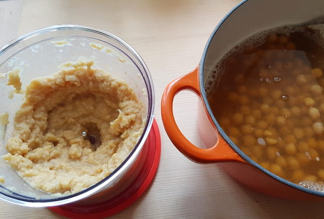 pureed chickpeas in blender and cooked chickpeas in pot
