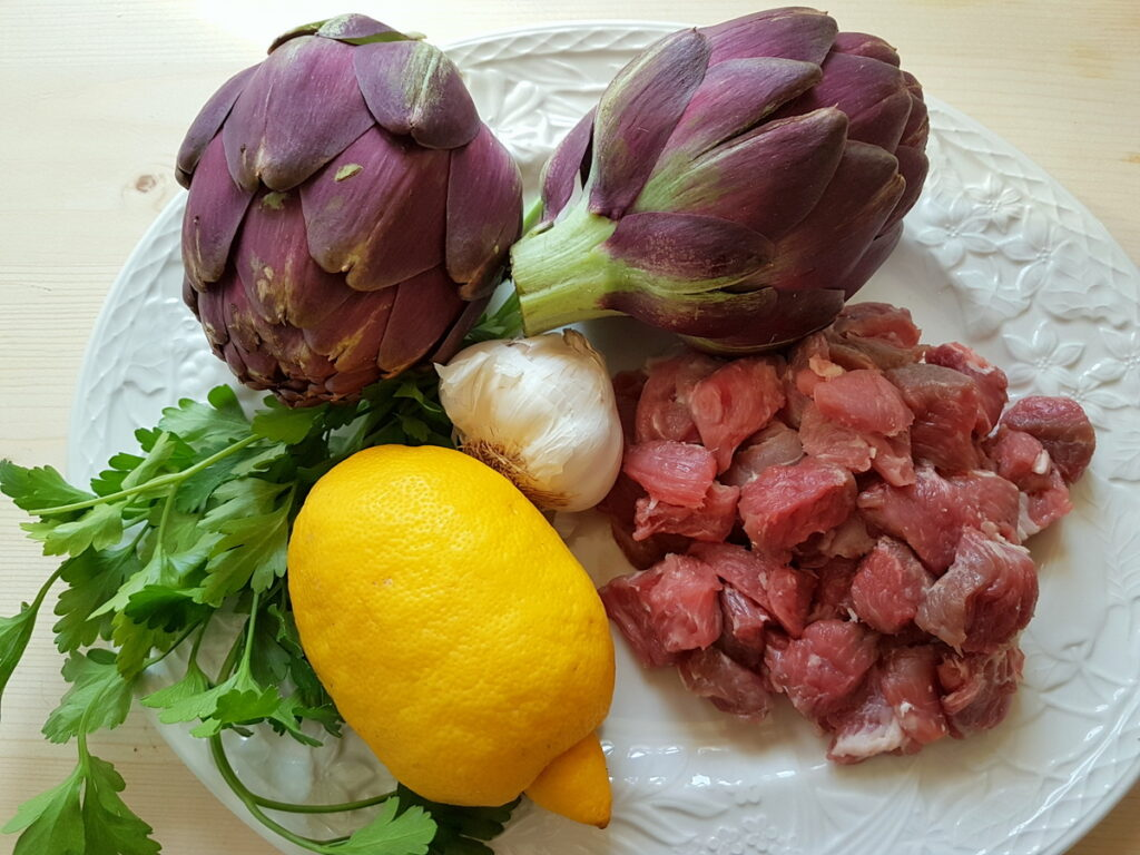 ingredients for pasta with lamb and artichokes on white plate
