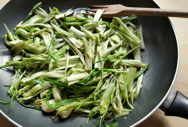 puntarelle cooking in frying pan