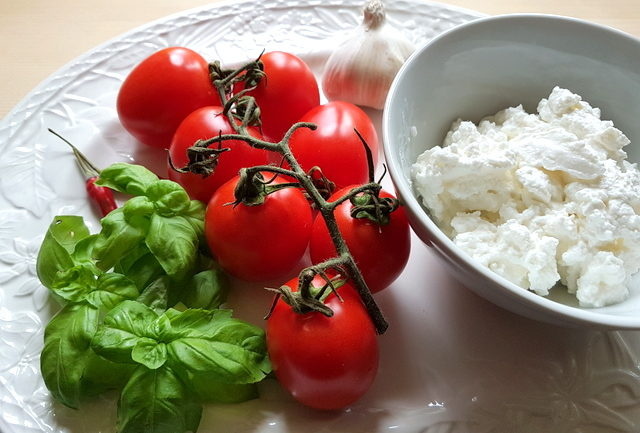 ingredients for ricotta and basil filled paccheri pasta with homemade tomato sauce