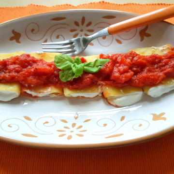 ricotta and basil filled paccheri pasta with homemade tomato sauce
