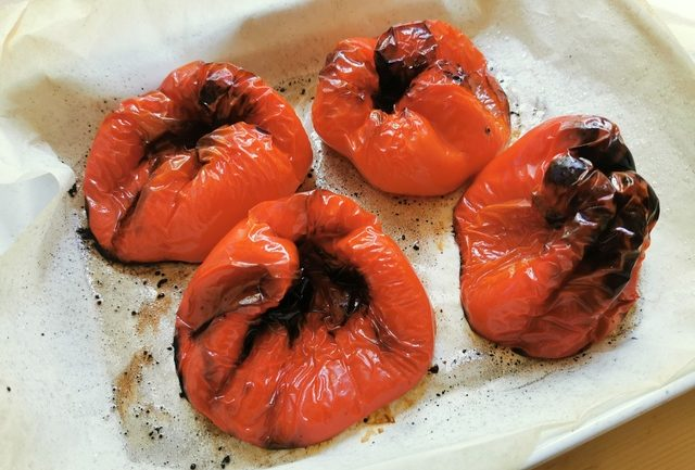 4 ready roasted red peppers on baking tray