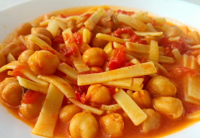 sagne pasta with chickpeas and tomatoes in white bowl