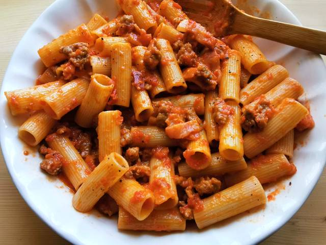 sausage rigatoni alla zozzona in white bowl ready to serve