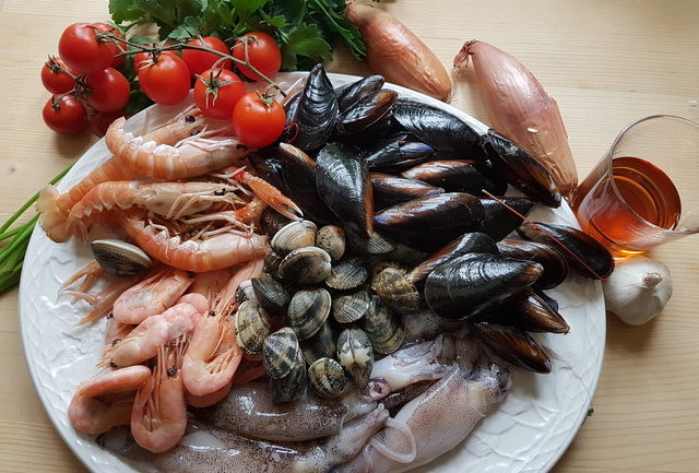 ingredients for seafood sauce on white plate