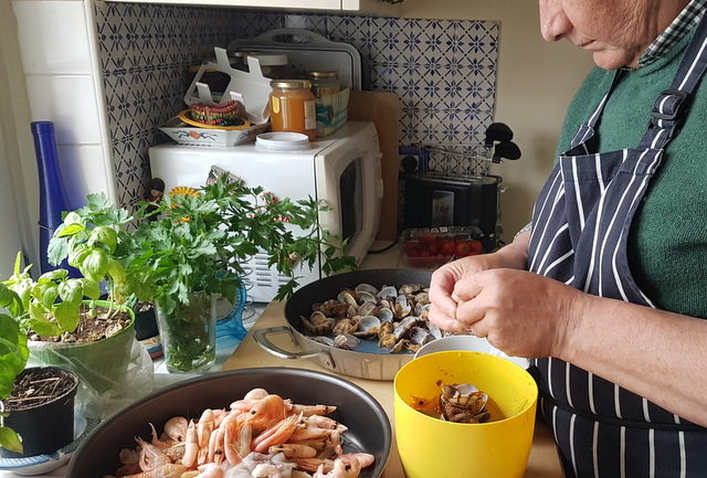 my Sicilian hubby preparing the seafood