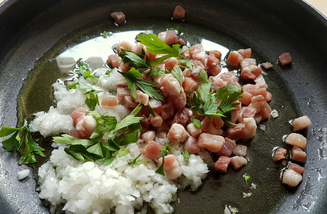 chopped onion, pancetta and parsley in frying pan
