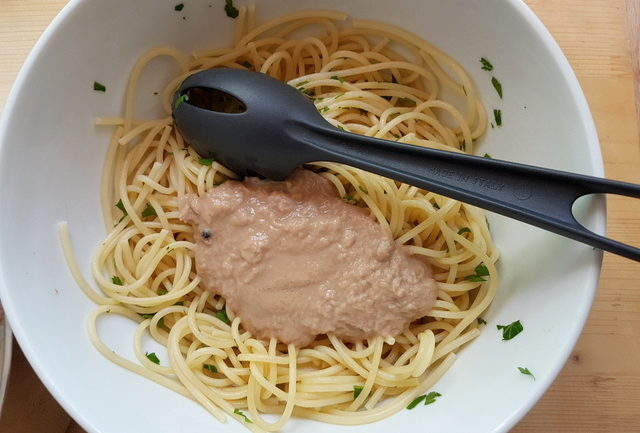 tuna and anchovy sauce on cooked vermicelli in white bowl