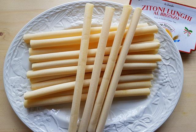 dried ziti pasta on white plate