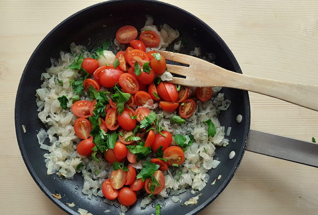 tomatoes, parsley, onions, garlic and lardo in skillet